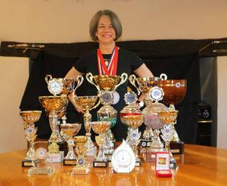 Catherine Walter with a table full of her trophies in spring 2018