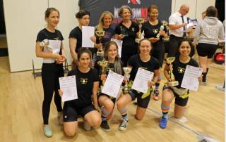 Photo of nine women in Linacre Ladies that Lift competition kit with certificates and trophies (BDFPA Full Power Championships 2018)